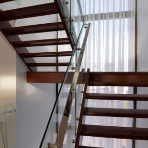 Custom Glass Balustrade on a Narrow Timber Staircase