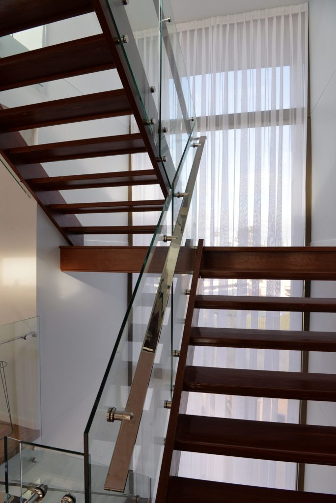 Custom Glass Balustrade on a Narrow Timber Staircase