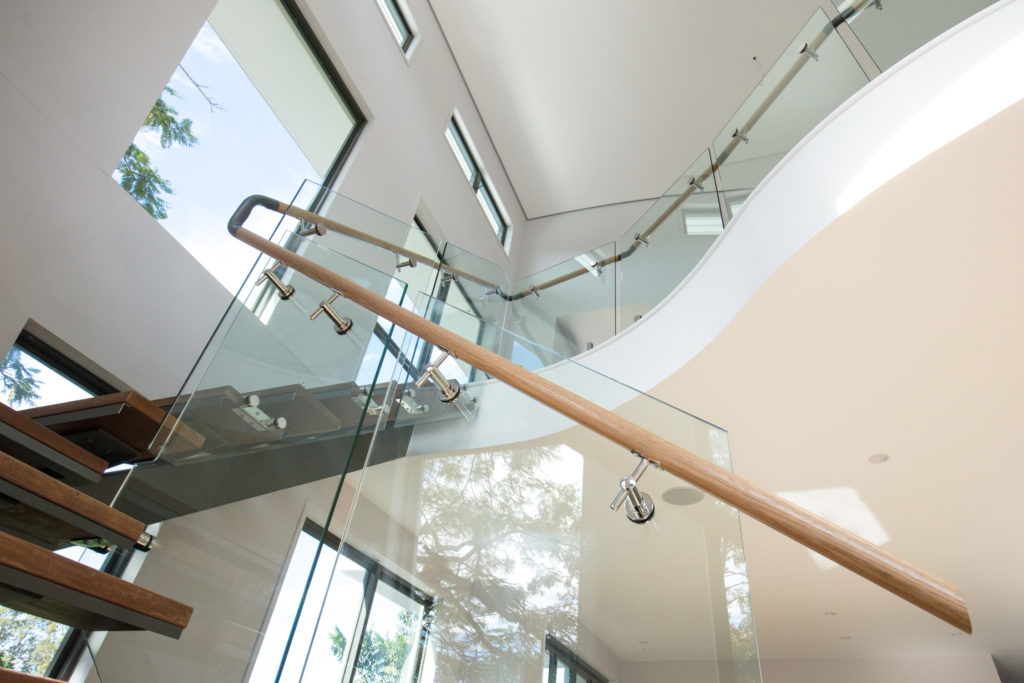 Custom Glass Staircase Fence with a Timber Hand Rail