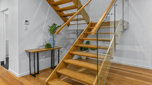 glass staircase fencing with timber handrails