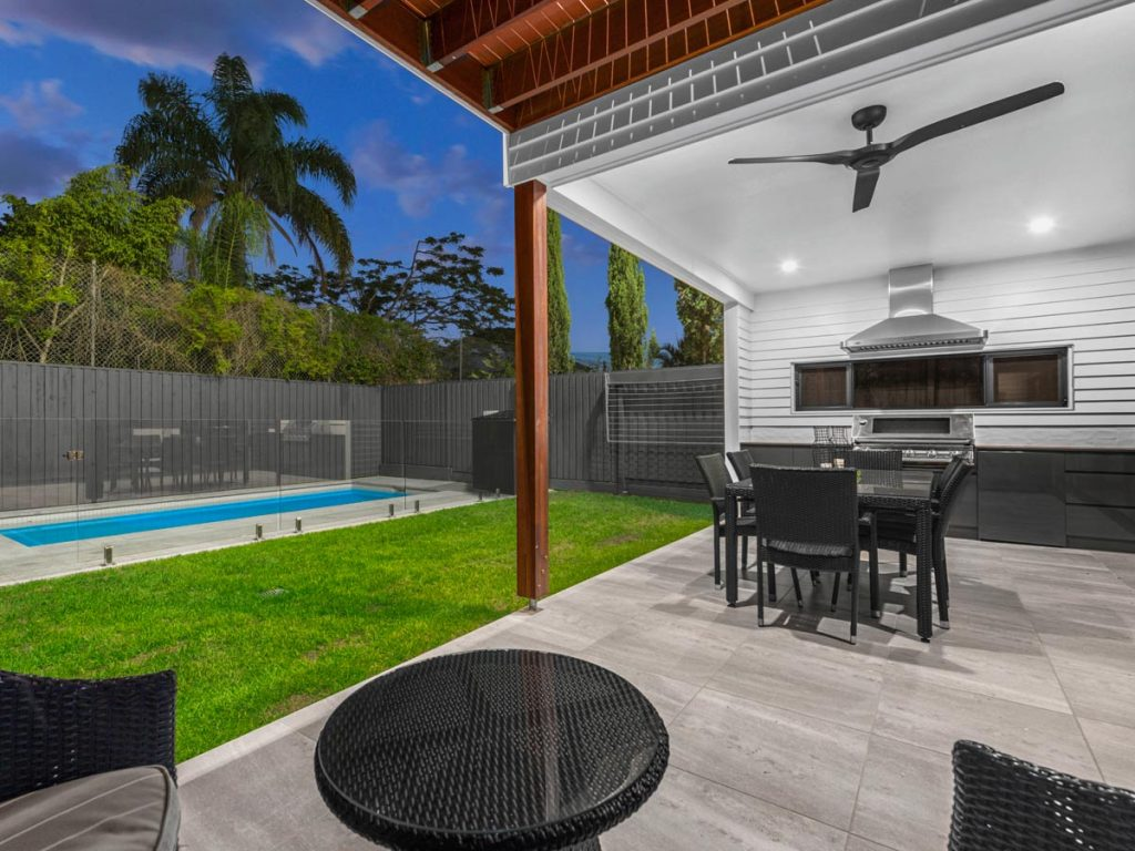 An Elegant Outdoor Entertaining Area with a Pool Fenced off Using a Frameless Glass Balustrade